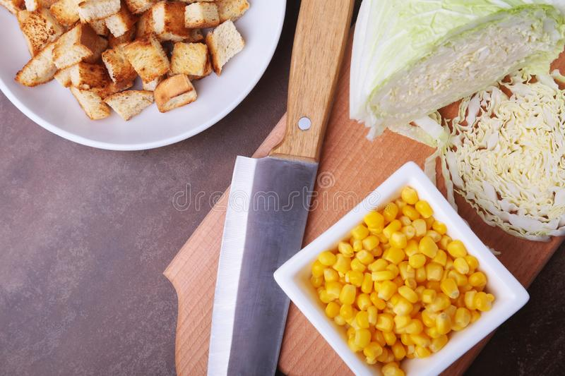 Fresh Chinese cabbage, Sweet canned corn, Delicious crispy croutons and canned tuna. Ingredients for dietary salad. royalty free stock image