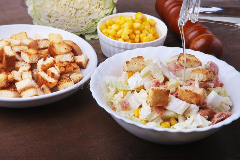 Fresh Chinese cabbage, Sweet canned corn, Delicious crispy croutons and canned tuna. Ingredients for dietary salad. stock photos