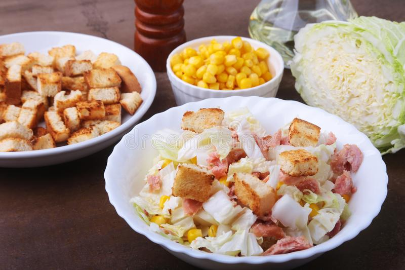 Fresh Chinese cabbage, Sweet canned corn, Delicious crispy croutons and canned tuna. Ingredients for dietary salad. stock photography