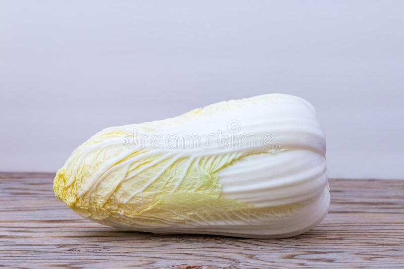 Fresh chinese cabbage on wood background. Close up of resh chinese cabbage on wood background stock images