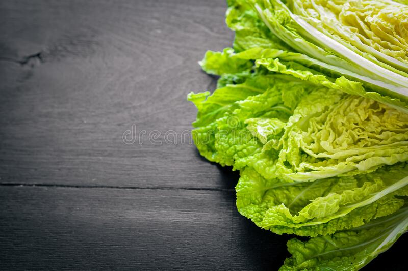 Fresh chinese cabbage on wooden table. Top view royalty free stock photo