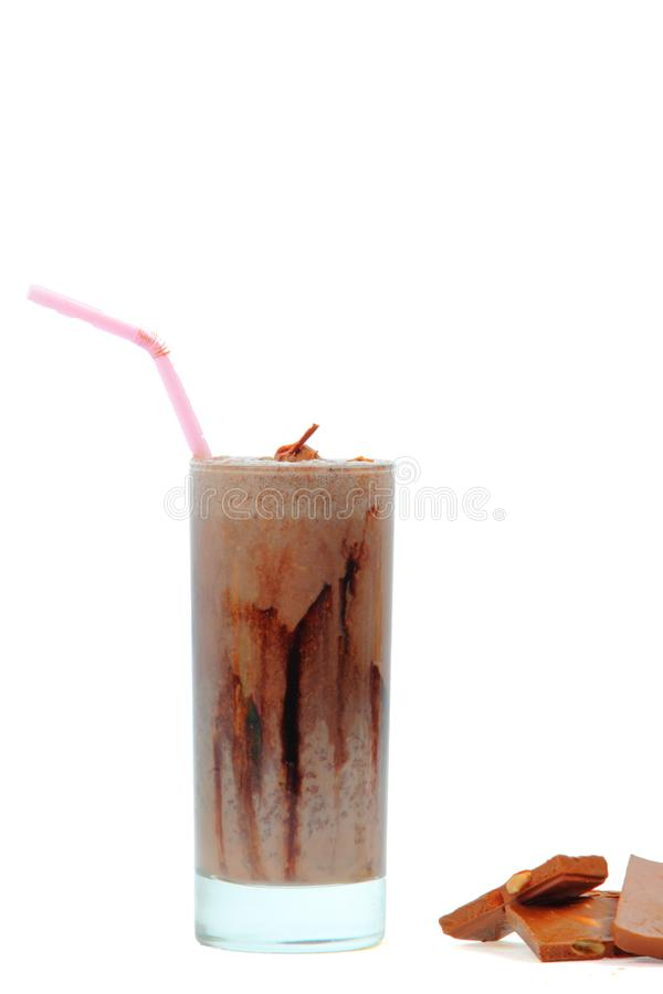 Fresh chocolates with cool juice in a glass with straw. Brownie chocolates with cool juice in a glass for a food presentation. This juice is made in indian royalty free stock photo
