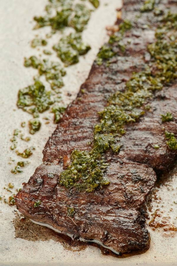 Fresh churrasco steak. On metal grill close up view royalty free stock image