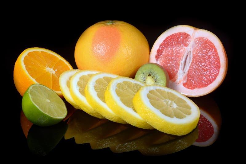 Download Fresh Citrus  On Black Background Stock Photo - Image: 83702059