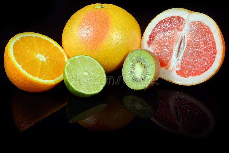 Download Fresh Citrus  On Black Background Stock Photo - Image: 83702642