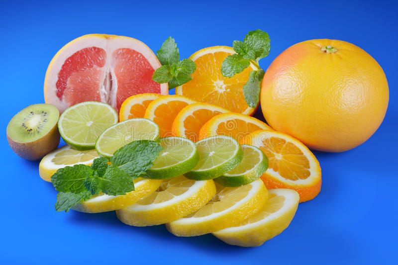 Download Fresh Citrus  On Blue Background Stock Photo - Image: 83702006