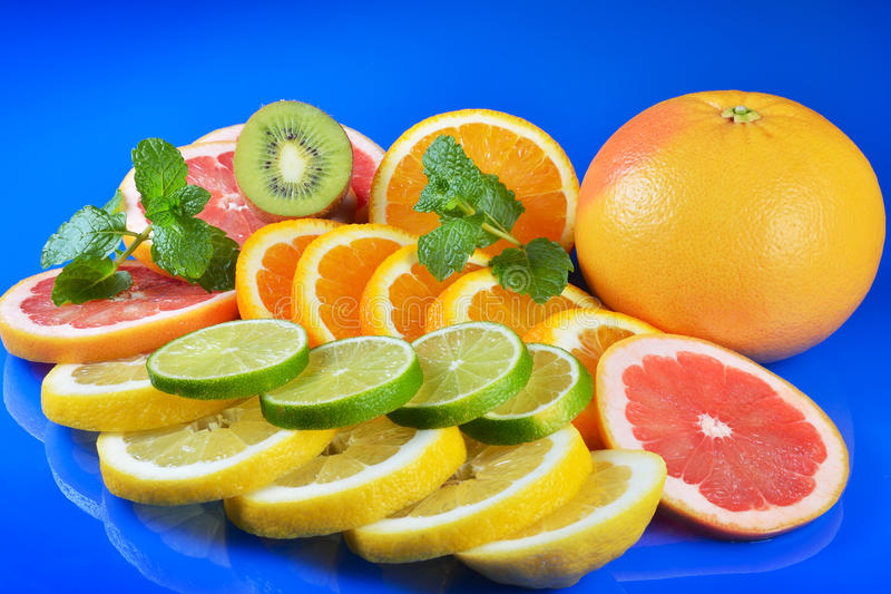 Download Fresh Citrus  On Blue Background Stock Image - Image: 83702089