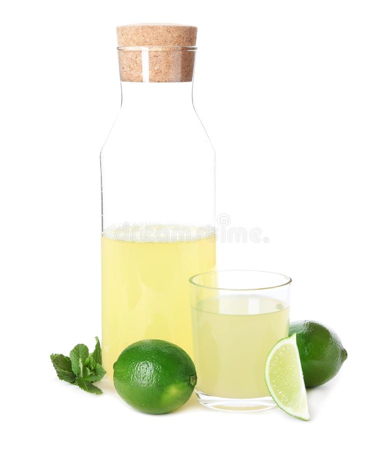 Fresh citrus drink in glassware and lime with mint on white background royalty free stock photos