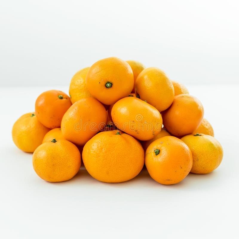 Fresh citrus fruits isolated on white background. Flat lay. Top view. Fresh citrus fruits isolated on white background. Flat lay stock photo
