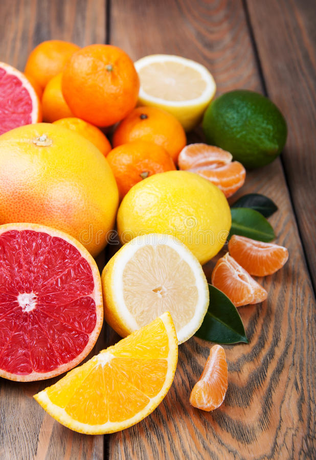 Fresh citrus fruits. On a old wooden table royalty free stock images