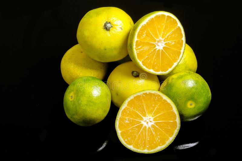 Fresh citrus fruits. Orange. On a black background.  royalty free stock images
