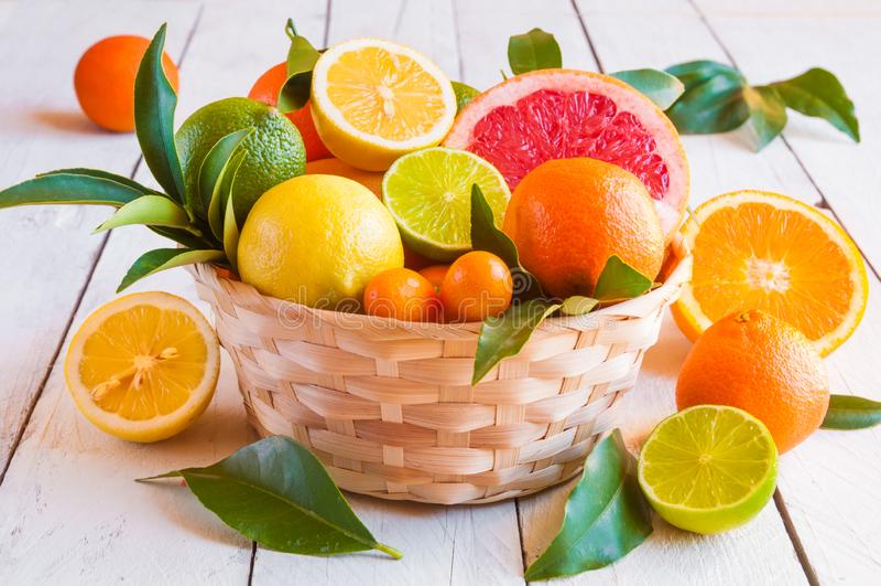 Fresh citrus fruits orange, lemon, grapefruit, mandarin, lime with leaves royalty free stock photography