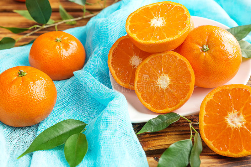 Fresh citrus fruits tangerines, oranges closeup in rustic style stock photography