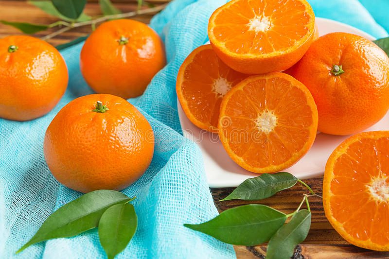 Fresh citrus fruits tangerines, oranges closeup in rustic style royalty free stock photo