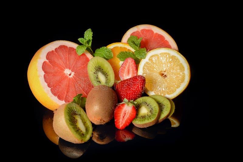 Download Fresh Citrus Isolated On Black Background Stock Photo - Image: 83702242