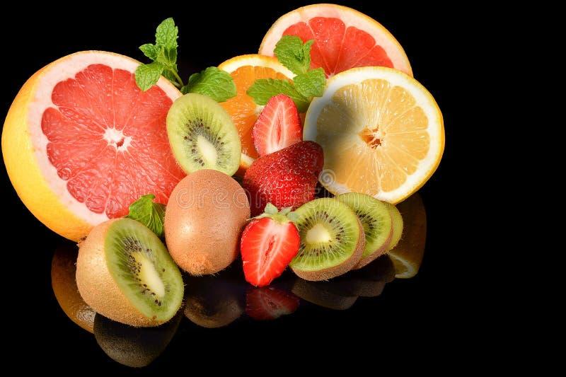 Download Fresh Citrus Isolated On Black Background Stock Photo - Image: 83702750