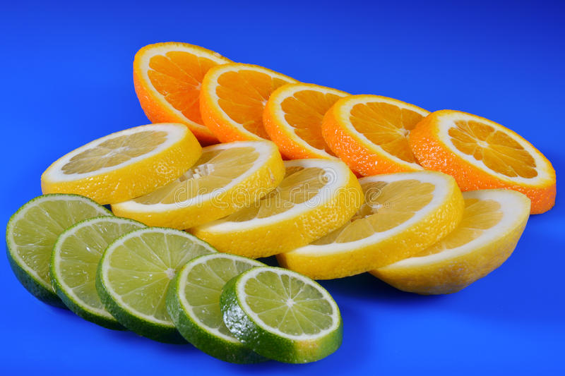 Download Fresh Citrus Isolated On Blue Background Stock Photo - Image: 83702500