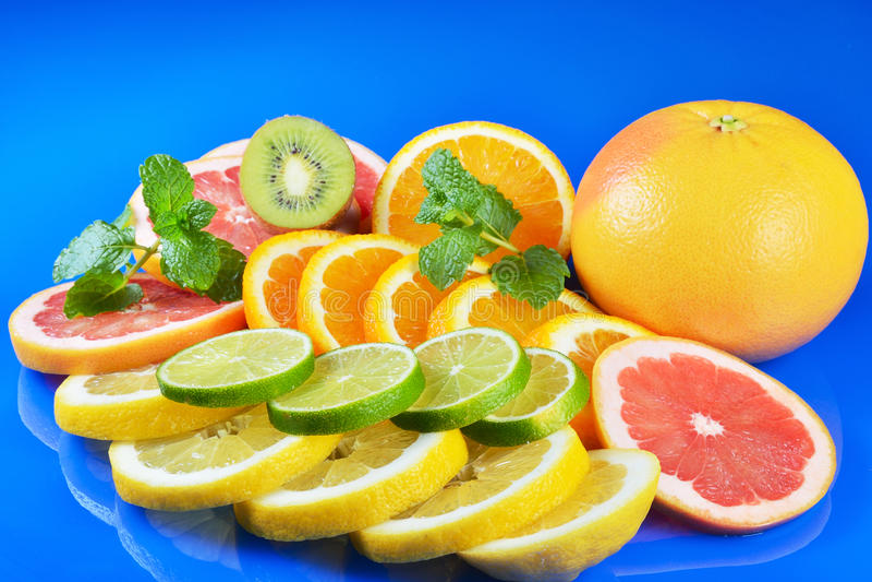 Download Fresh Citrus Isolated On Blue Background Stock Photo - Image: 83702548