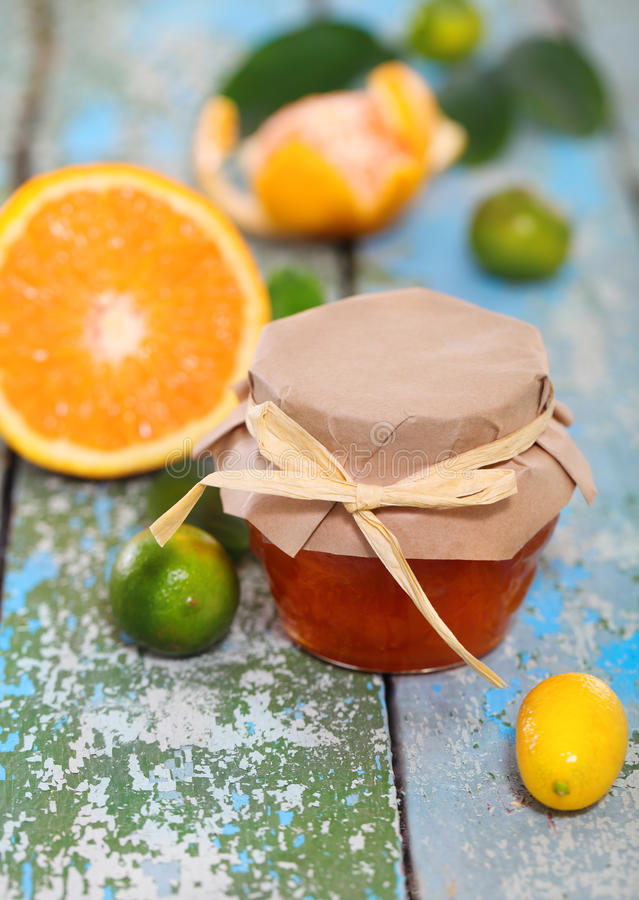 Fresh citrus jam and fruits royalty free stock images