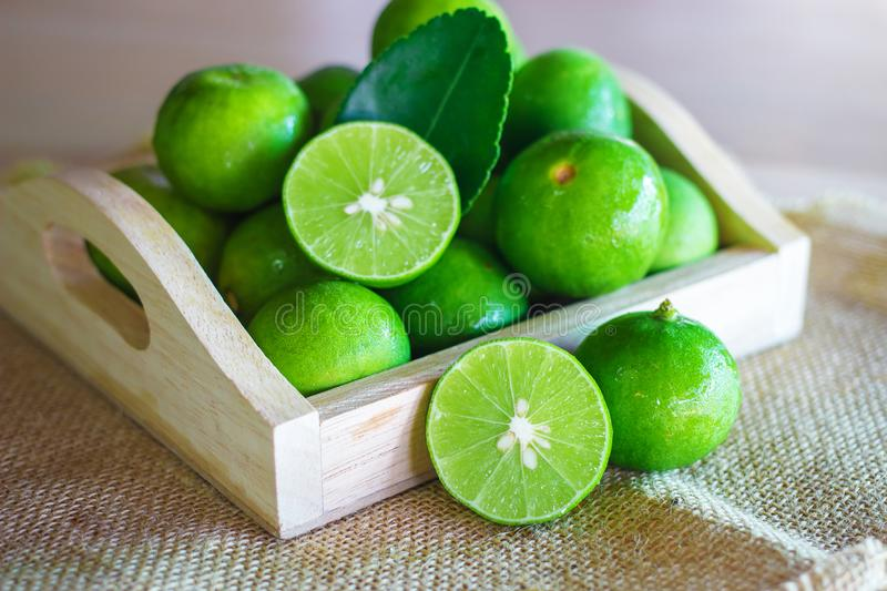 Fresh Citrus lime fruit in wooden box. Fresh organic of citrus lime fruit in a wooden box royalty free stock photography