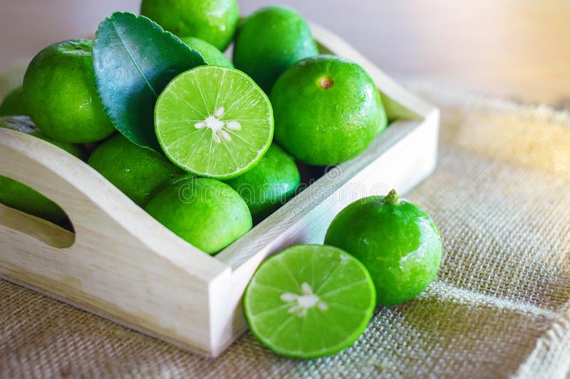 Fresh Citrus lime fruit in wooden box. Fruits and vegetables royalty free stock images