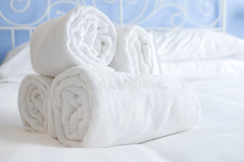 Fresh and clean nicely rolled up towels lie on a bed royalty free stock image
