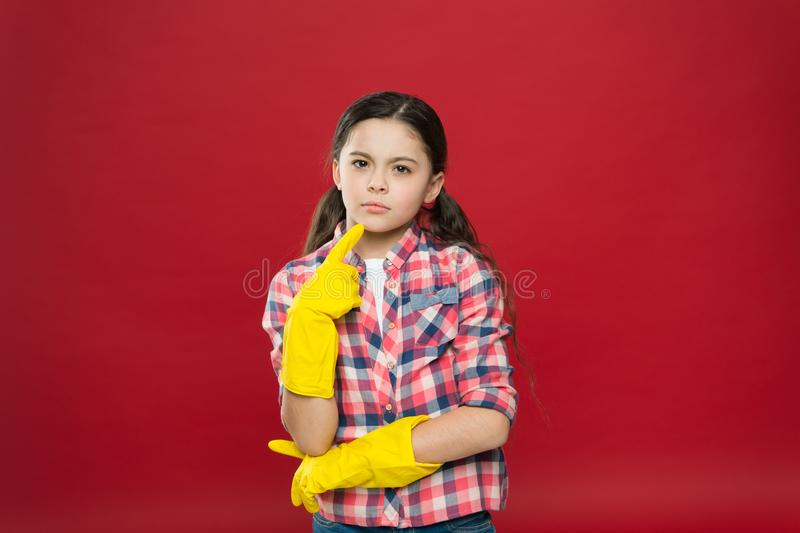 So fresh and so clean. Thoughtful child wear rubber gloves red background. Household work. Housekeeping routine. Cleaning service. Cleaning and sanitation stock photography