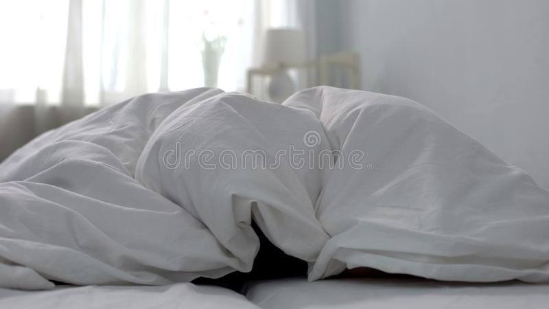 Fresh and clean white bed linen in hotel room, washing powder quality, service. Stock photo stock photos
