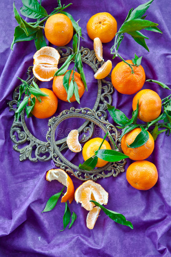 Fresh Clementines On Purple Stock Photography