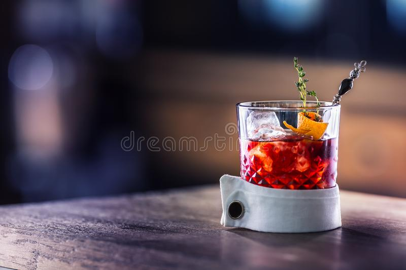 Fresh cocktail drink with ice fruit and herb decoration. Alcoholic, non-alcoholic drink-beverage at the bar counter in the pub. royalty free stock photo