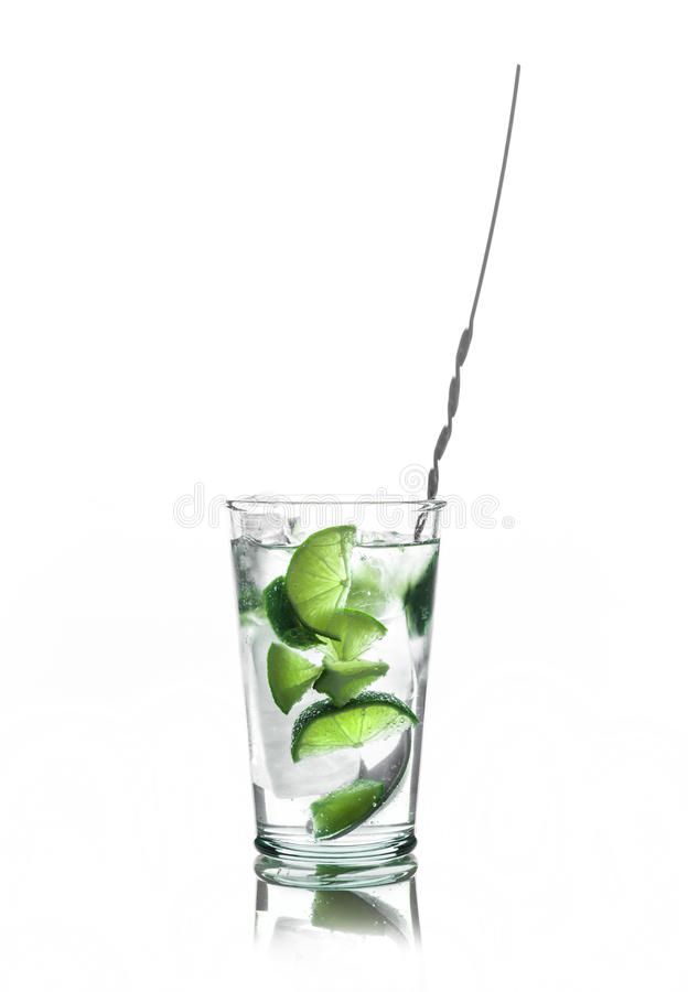 Fresh cocktail with lime slices. Isolated on white background stock images