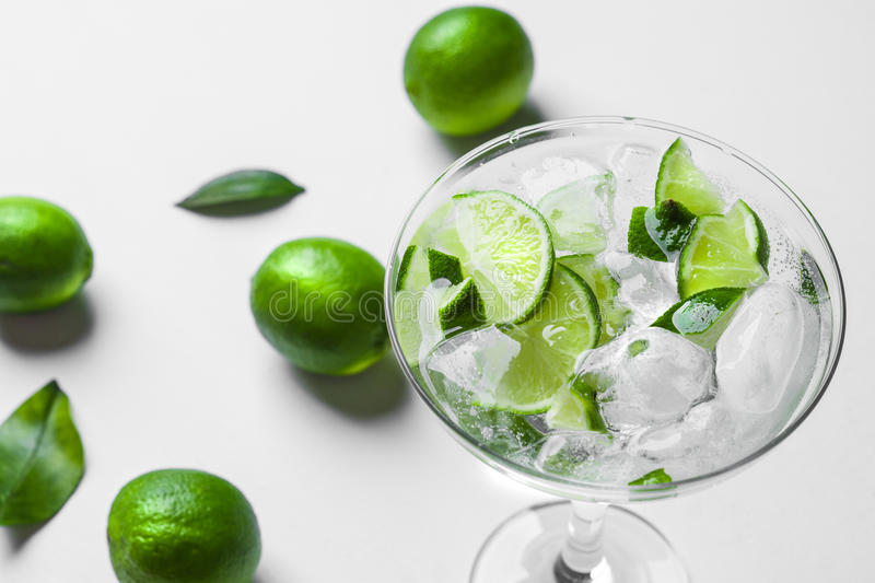 Fresh cocktail with lime slices. On white background royalty free stock photos