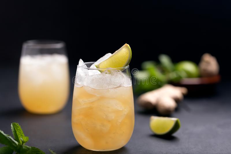 Fresh cocktail prepared with ginger beer, lime and ice stock photography