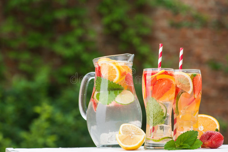 Fresh cocktail with strawberry, orange, mint and ice royalty free stock photos
