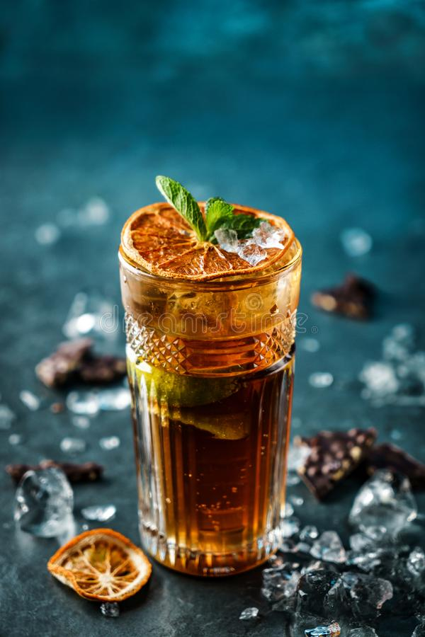 Free Fresh Cocktail With Cola, Lime, Chocolate And Ice In Glass On Dark Blue Background. Summer Cold Drink And Cocktail Stock Images - 153573084