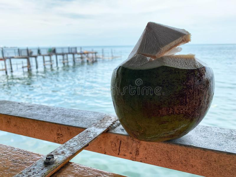 Fresh coconut drink at Bangsaen Beach locating at Chonburi province in Thailand. Fresh coconut drink at the restaurant on Bangsaen Beach locating at Chonburi royalty free stock photos