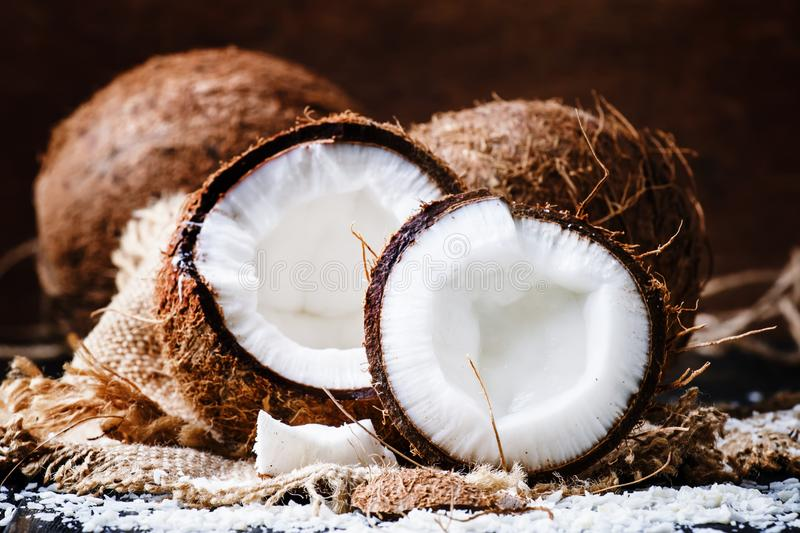 Fresh coconut, selective focus food still life. Fresh coconut on wooden table, selective focus food still life royalty free stock photo