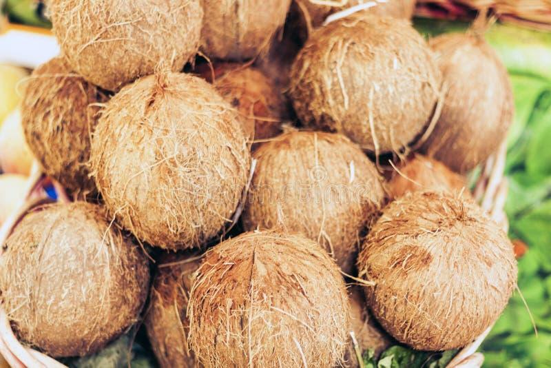 Fresh coconuts in the fruit market, Catania, Sicily, Italy.  stock photos