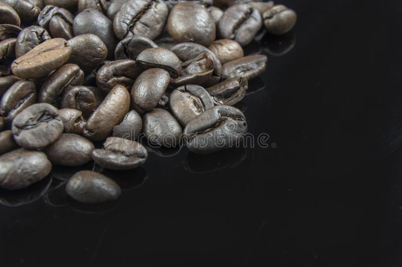 Fresh Coffee Beans Close Up with a Black Background.  royalty free stock photography