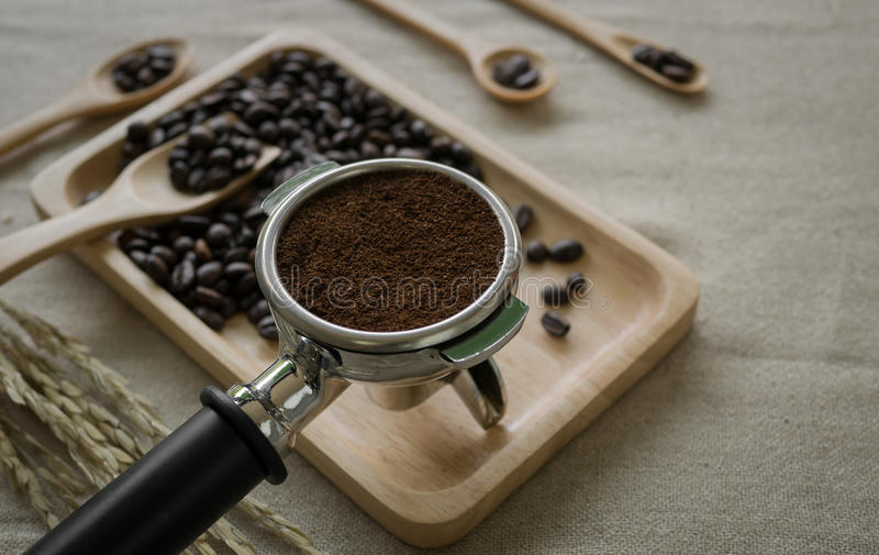 Fresh coffee beans and coffee maker prepared on the desktop. Coffee beans and coffee maker prepared on the desktop stock photography