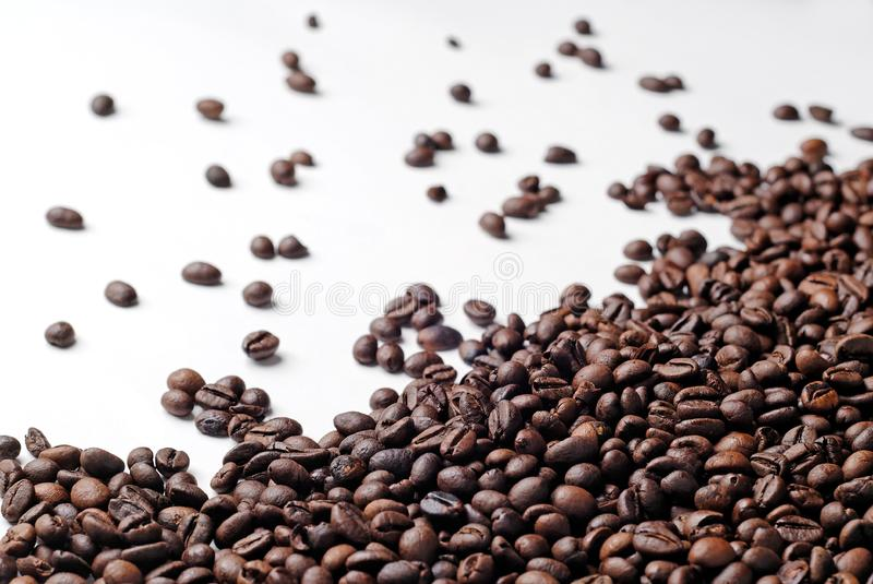 Fresh coffee beans spread royalty free stock images