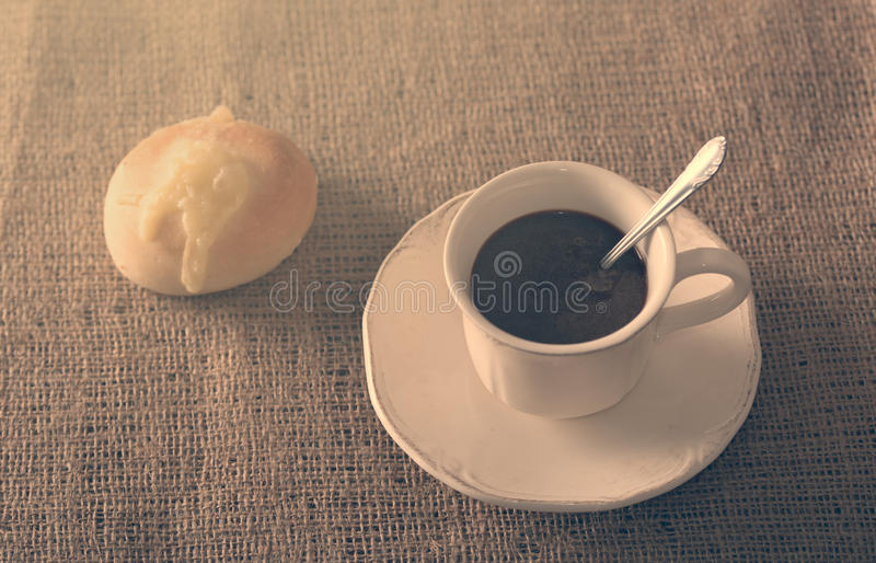Fresh coffee and cheese bread royalty free stock photos