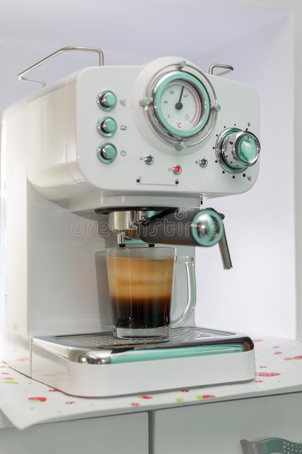 Fresh coffee with machine stock photo