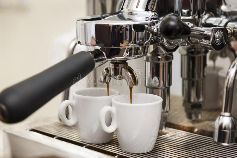 Fresh coffee prepared. In the coffee machine royalty free stock photography