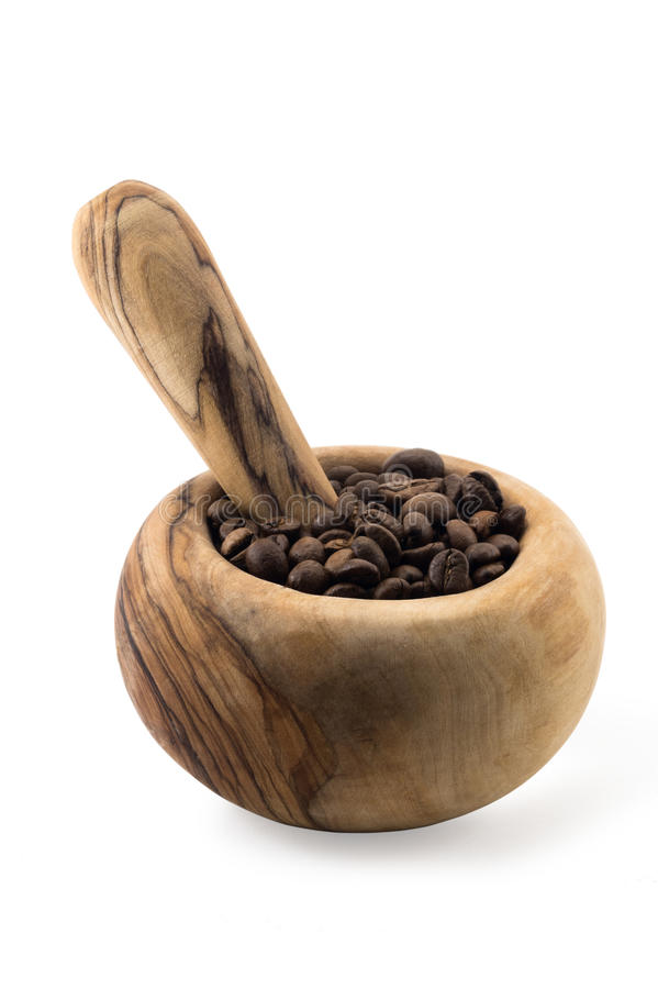 Fresh coffee in wood mortar isolated on white royalty free stock photography