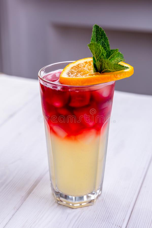 Fresh cold cocktail with cherry, orange and mint in misted glass. Non-alcoholic summer coctails. Menu of cafe or restaurant.  stock photo
