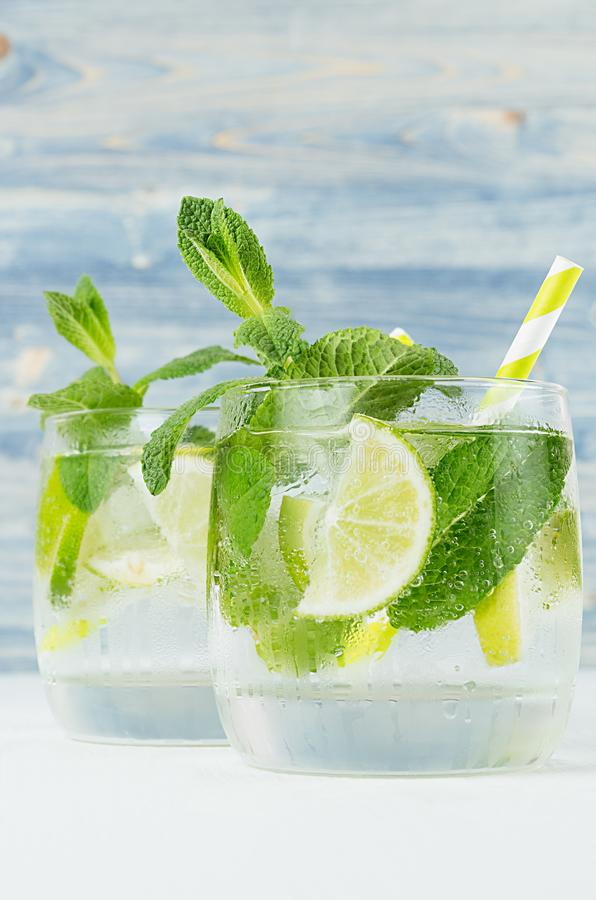 Free Fresh Cold Summer Beverage Gin And Tonic With Lime, Leaf Mint, Straw, Ice Cubes, Soda On Light Blue Wooden Background, Closeup. Royalty Free Stock Image - 120962526
