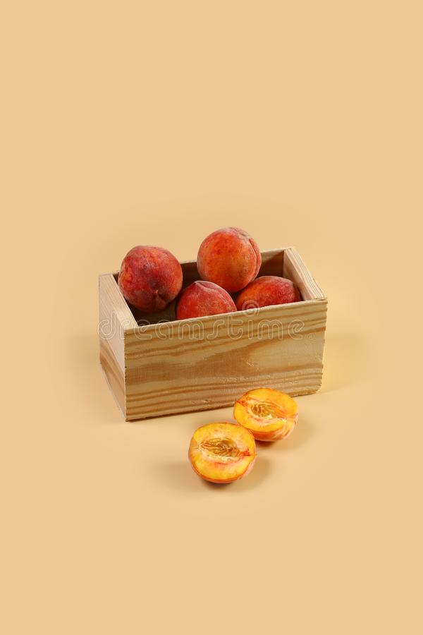 Fresh colorful flat peaches donut peaches Isolated on a beige background. Top view. Free space for your text royalty free stock photography