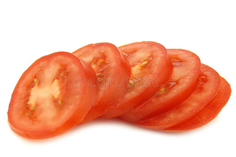 Fresh and colorful italian roma tomato slices royalty free stock photo
