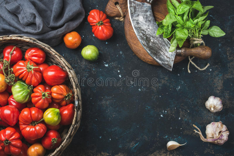 Fresh colorful ripe heirloom tomatoes in basket, copy space stock photos